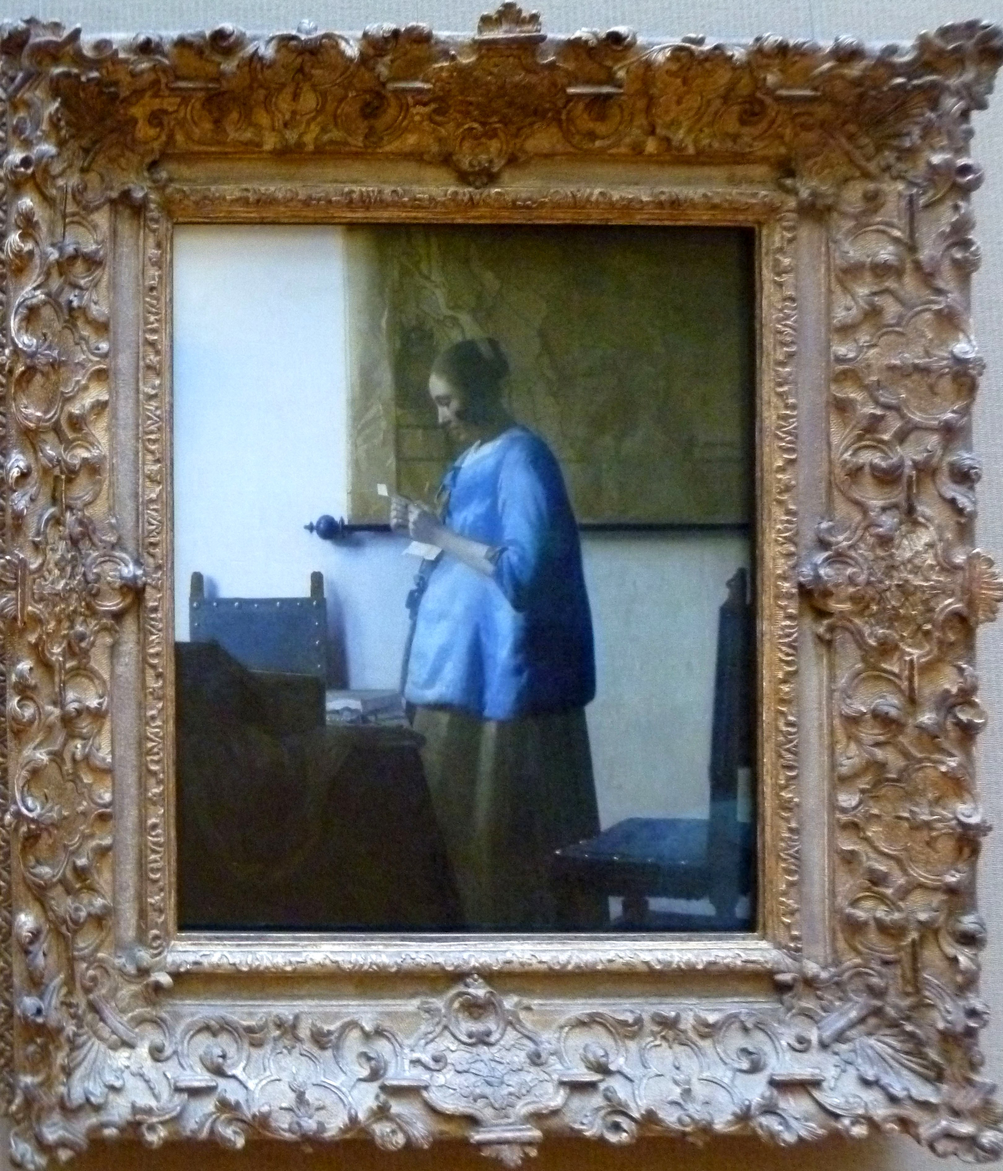 woman in blue reading a letter in blue reading a letter a pigment of your imagination 25664 | womaninbluereadingaletter